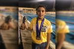 كريم أحمد إبراهيم يحصد كأس أحسن سباح ببطولة الجمهورية للسباحة تحت ١٢ سنة